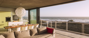 Modern living room and dining room overlooking ocean - CAIF18825
