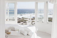 White bedroom overlooking ocean - CAIF18876