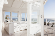 White bedroom overlooking ocean - CAIF18882