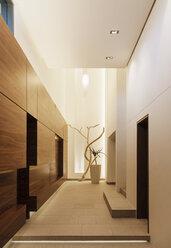 Wood paneling in modern corridor - CAIF18963