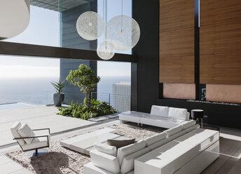 Modern living room overlooking ocean - CAIF18966