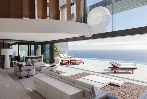 Living room in modern house overlooking ocean - CAIF19041