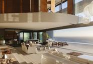 Living room in modern house overlooking ocean - CAIF19050