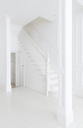 Staircase in white foyer - CAIF19251