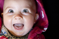 Close up of baby girl's laughing face - CAIF19266