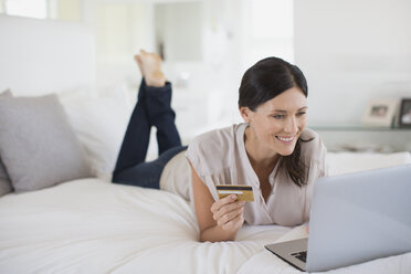 Woman shopping online with laptop - CAIF19344