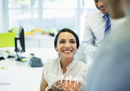 Business people celebrating birthday in office - CAIF19428