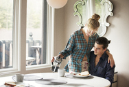 Couple having breakfast at home - CAVF10023
