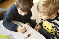 High angle view of siblings drawing on paper at home - CAVF10110