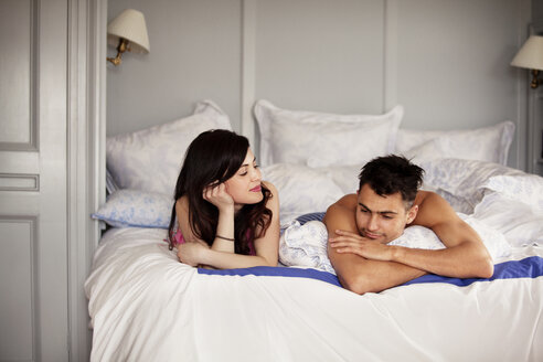 Couple relaxing on bed at home - CAVF10167