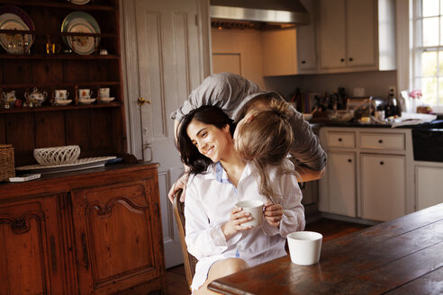 Man kissing girlfriend in kitchen - CAVF10188