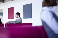 Businessman sitting in lobby - CAIF19456