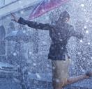 Businesswoman dancing in rain - CAIF19719