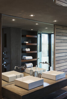 Sinks and mirror in modern bathroom - CAIF19827