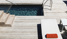 Pool and wooden deck of modern house - CAIF19830