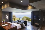 Modern bedroom overlooking ocean - CAIF19833