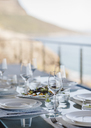 Set table on luxury patio - CAIF19842