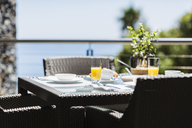 Breakfast on luxury patio dining table overlooking ocean - CAIF19863