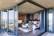 Doors on patio open to modern bedroom - CAIF19872