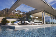 Swimming pool and patio outside modern house - CAIF19923