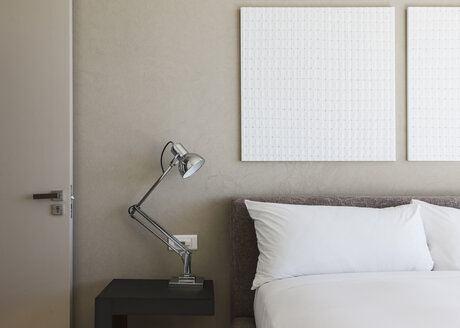 Lamp and wall art in modern bedroom - CAIF19950