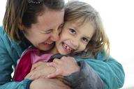 Happy mother embracing daughter - CAVF10431