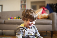 Happy boy relaxing at home - CAVF10524