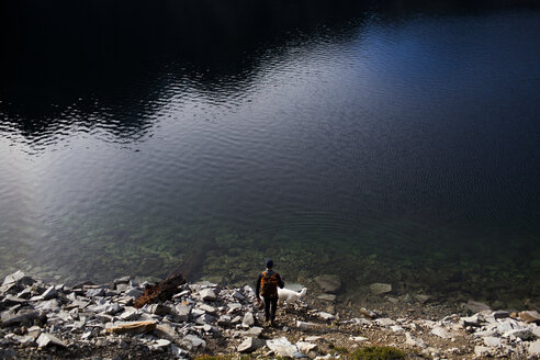 High angle view of dog and hiker by Snow Lake - CAVF10590