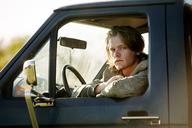 Portrait of man sitting in car - CAVF10636