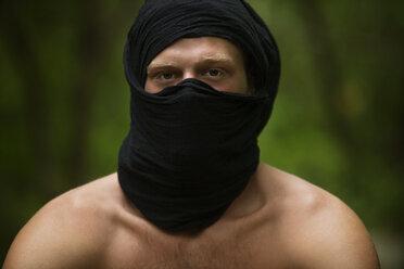 Portrait of shirtless man wearing black scarf - CAVF10684