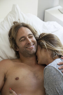 Couple embracing on bed at home - CAVF11227