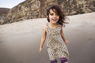 Happy girl enjoying on shore at beach - CAVF11692