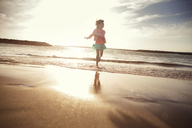 Playful girl in water at beach - CAVF11695