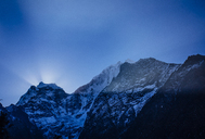 Low angle view of snowcapped mountains against blue sky at dusk - CAVF12405