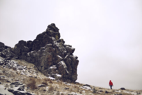 Distant view of hiker walking on mountain against clear sky - CAVF12984