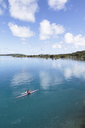 High angle view of man canoeing in lagoon of Bora Bora against sky - CAVF13329