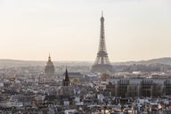 Eiffel tower in city against clear sky during sunset - CAVF13413