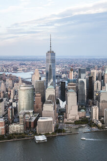High angle view of One World Trade Center by Hudson river against sky in city - CAVF13425