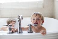 Boys playing in bathtub at home - CAVF13485