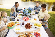 High angle view of multi generation family enjoying on picnic table - CAVF13803