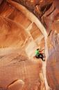 Side view of man climbing mountain - CAVF14160