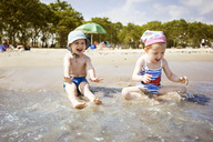 Children playing in water at beach - CAVF14199