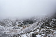 Scenic view of snowcapped mountain during foggy weather - CAVF15117