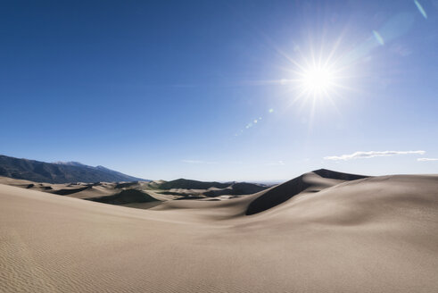 Scenic view of great sand dunes national park on sunny day - CAVF15135