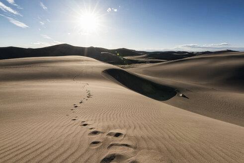Scenic view of desert landscape on sunny day - CAVF15150
