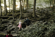High angle view of siblings walking on rocks in forest - CAVF15581