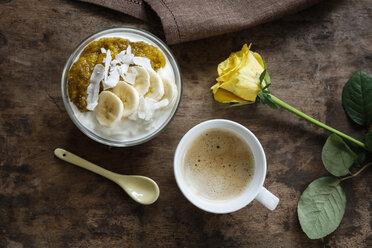 Chia mango yogurt with banana and cup of coffee - EVGF03311