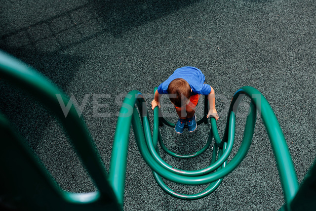 High angle view of boy playing on outdoor play equipment - CAVF16019 - Cavan Images/Westend61