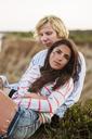Portrait of woman sitting with boyfriend - CAVF17073