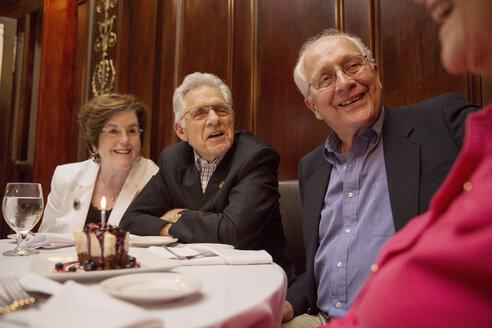 Senior friends talking while sitting in restaurant - CAVF17190